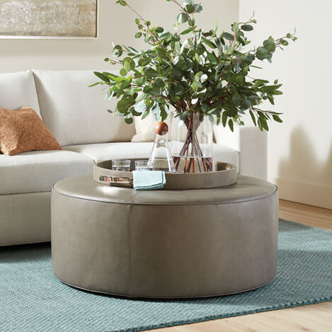 Dallon Leather Round Ottoman Product Tile Hover Image 721020
