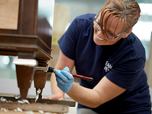employee gilding furniture