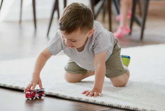 child playing on rug