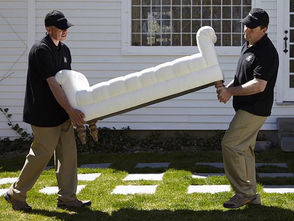 men carrying sofa